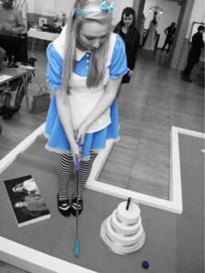 Alice In Wonderland plays crazy golf